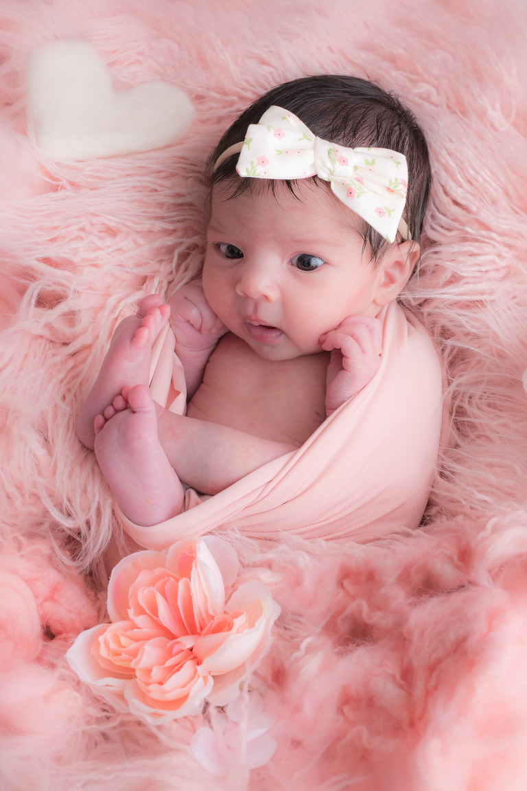 Newborn baby girl in pink